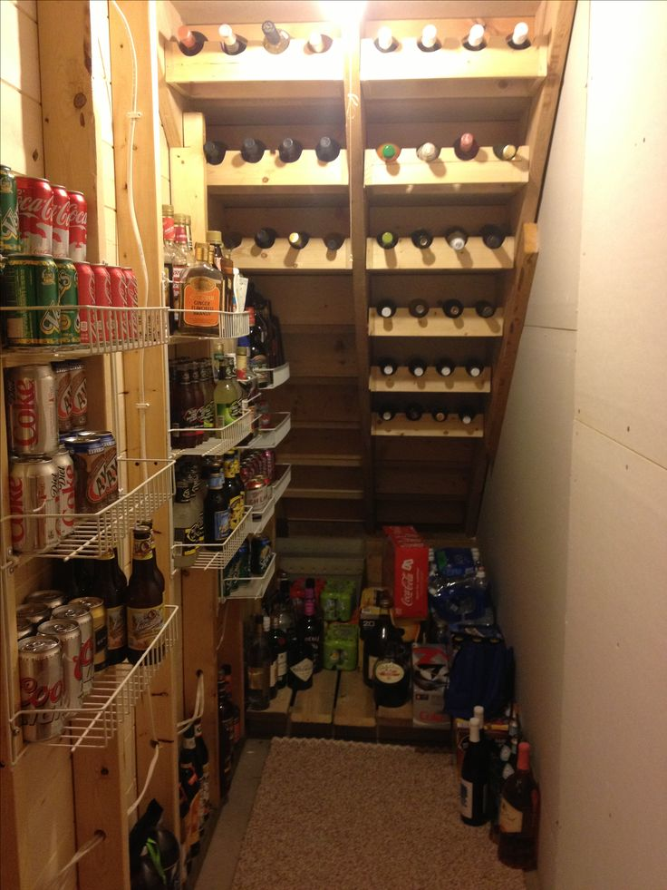 Wine Cellar!  Make use of under the stairs space. Awesome.