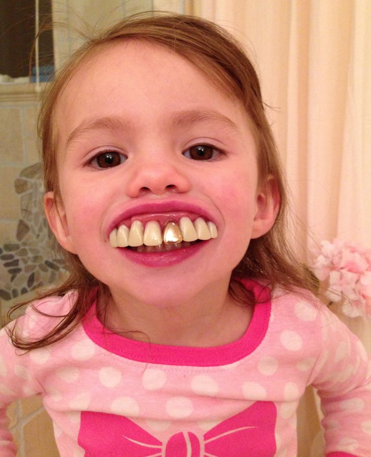 What happens when your kids find your stash of prosthetic teeth in your make-up special fx supplies...these pictures crack me up: