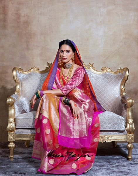 A banarasi handloom multi color sari which is crafted in zari woven booti and border all-over. It is paired with a brocade blouse piece in magenta color. This saree is appropriate for occasion such as parties, wedding party, wedding wear and bridal wear. By Meena Bazaar (MeenaBazaar.in)