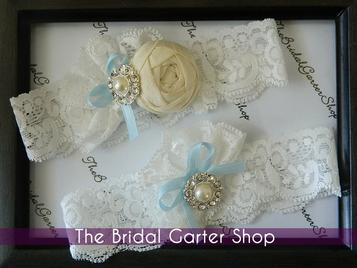 Wedding Garter in an off-white stretch lace with silk cabbage rose. $22.00, via Etsy.