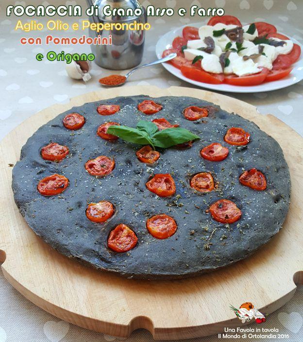 Focaccia con farina di Grano Arso e Farro all'aglio, olio e peperoncino con Pomodorini e Origano