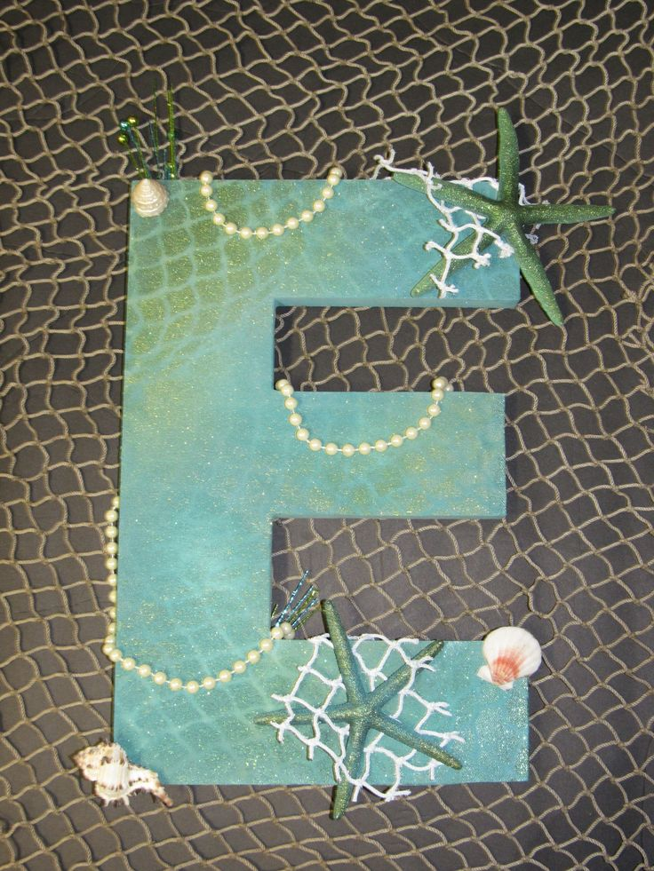 """I created this letter """"E"""" for my nieces 3rd Birthday Present. It is a Little Mermaid themed. The letter was solid white when I bought it, added some fish scale textures and nice oceans colors to tie in together. Added some pearls, starfish, shells and netting for some texture and contrast."""