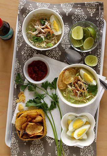 SOTO AYAM. ( Classic Indonesian aromatic chicken soup Recipe. A yellow spicy chicken soup and usually served with rice. Vermicelli (rice noodles) is often added to Soto. Turmeric (Kunyit) is added as one of its ingredients to get yellow chicken broth. Besides chicken and vermicelli, it is also served with hard-boiled eggs, slices of fried potatoes, Chinese celery leaves, and fried shallots ).