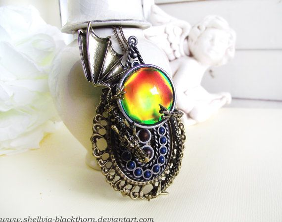 http://www.etsy.com/listing/156604993/world-of-warcraft-dragon-amulet-pendant?ref=shop_home_feat