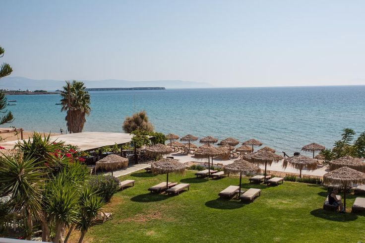 Golden Beach Hotel || Located right on Chrissi Akti Beach in Paros, Golden Beach Hotel features a lawn terrace with umbrellas and sun loungers, and a sea-view restaurant. Water sport facilities are also available on site.
