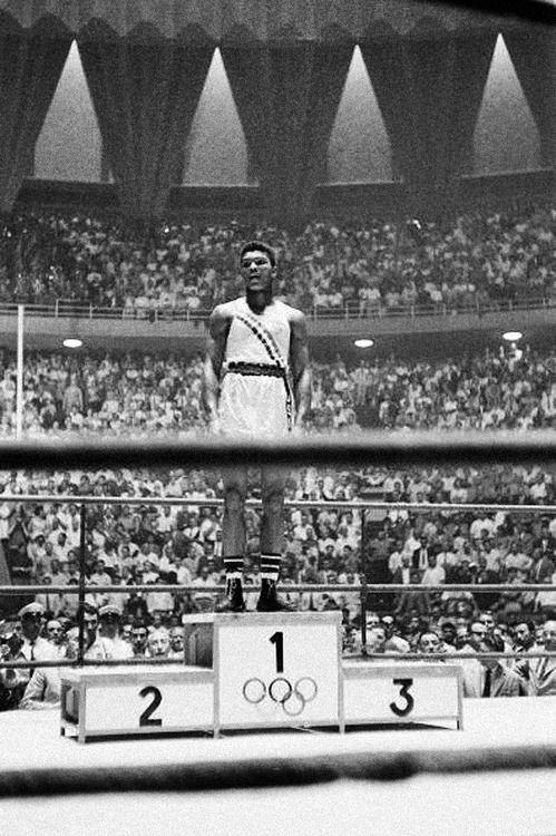September 5, 1960:Cassius Clay (Muhammad Ali) captures light heavyweight gold medal at the Rome Olympics.  Photo:Jerry Cooke/Sports Illustrated/Getty