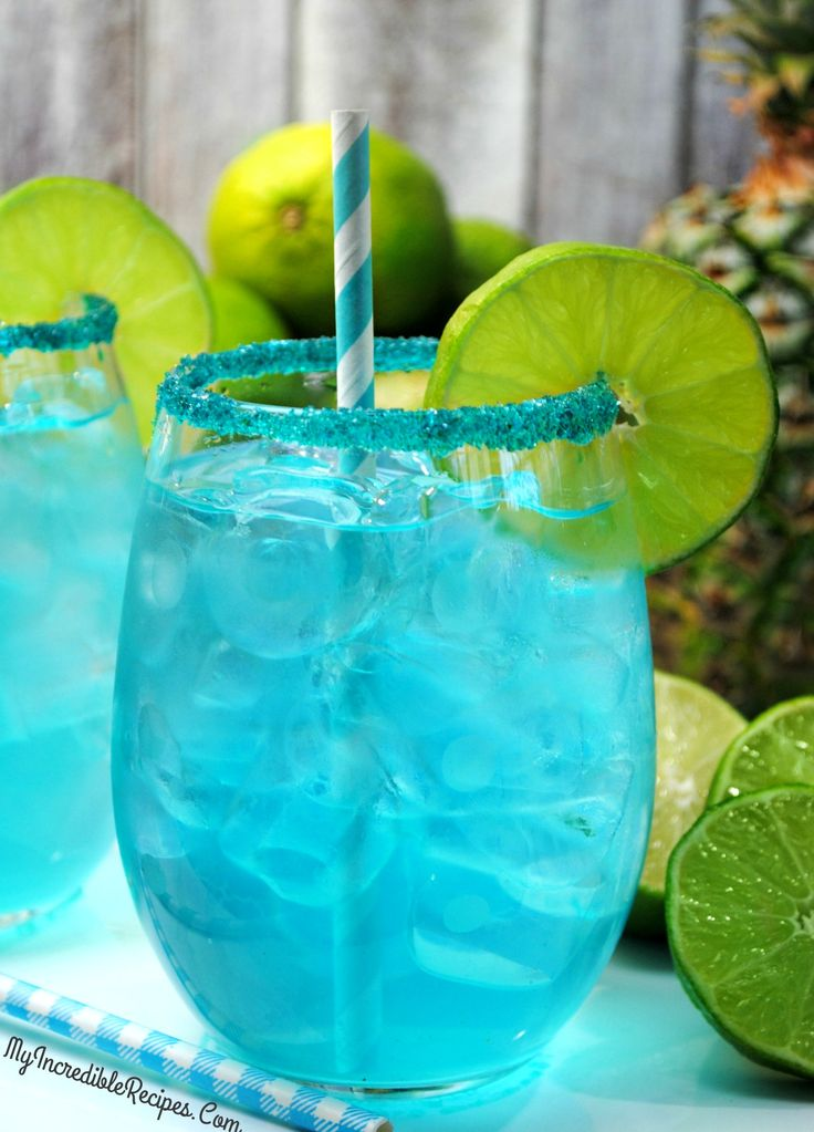 Kinky Pineapple Margarita! -  http://recipesheaven.com/kinky-pineapple-margarita - Deliciously fruity treat that you are going to love! These beautiful drinks you see before your eyes are Kinky Pineapple Margaritas! I say 'Kinky' because that is the kind of liqueur it uses! (Kinky Blue) which is what gives it that pretty color!  My all time most favorite drink (with alcohol) is margaritas!  I am a huge fan of beautiful drinks because I swear it makes them taste be