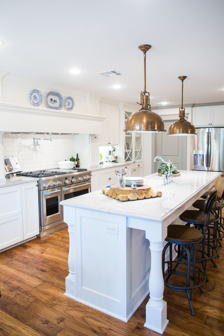 All-white kitchen from HGTV's Fixer Upper | Photography: Rachel Whyte - rachel-whyte.com/ | View entire slideshow: Fixer Upper Homes on http://www.stylemepretty.com/collection/3870/