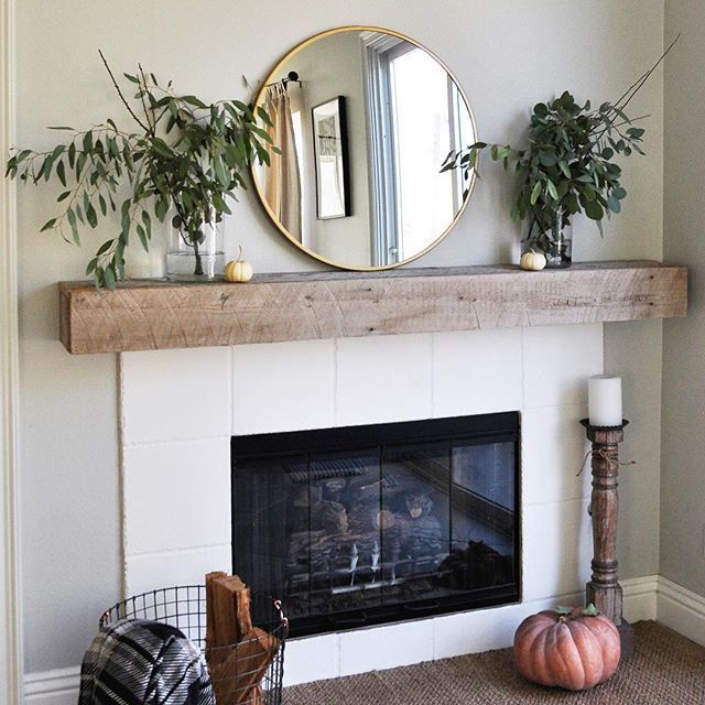 "We did a little project this morning, do you see it? We wrapped our existing mantel with reclaimed 100 year old barn wood. We debated taking the original mantel down and buying a beam but after all the demo and cost we opted to do this instead. Our fireplace is offset and not a focal point in the room, I guess the builder decided for us that our fireplace was a ""courtesy"" since we live in the hot box of California. I think we made a good choice and for $53 plus tax, you can't beat it…"