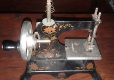 VINTAGE TOLE DECORATED GERMAN MADE TOY SEWING MACHINE EAGLE MARK GERMANY