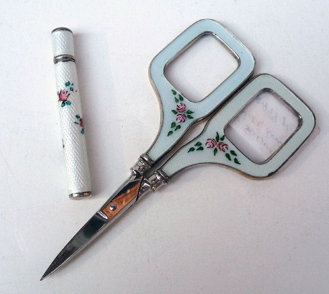 Sterling Silver Guillouche embroidery scissors and needle case. Saw a brand new set of this type of scissors with a matching thimble many years ago and didn't buy them. Many regrets ...