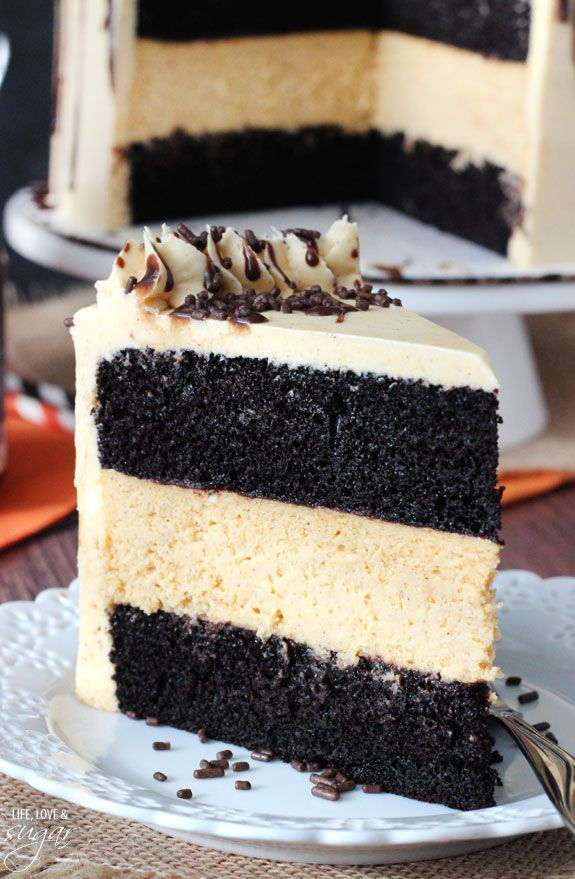 Chocolate Pumpkin Cheesecake Cake - chocolate cake, pumpkin cheesecake and pumpkin icing combine into this delicious cake!