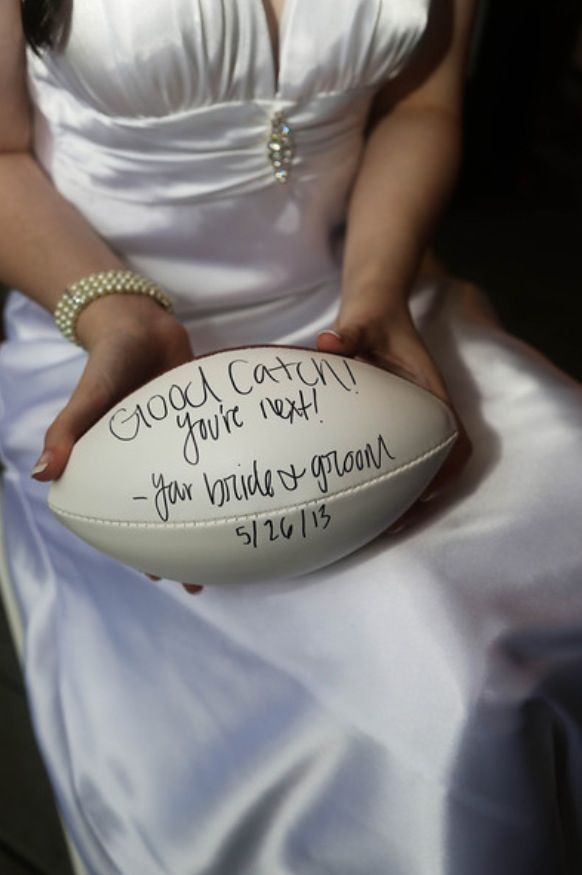 Our idea for the garter toss, put it around a football to throw...we ♥ this! moncheribridals.com