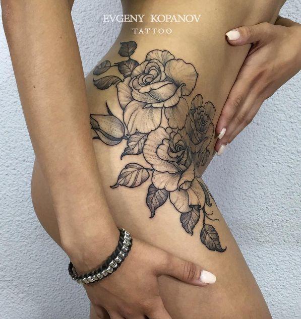 Vintage blackwork roses on hip by Evgeny Kopanov