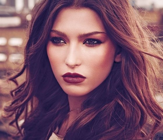 Beautiful Dark Autumn colours. Hair is often not especially dark. Purple in lip colour would look about like this. The contouring has strength. The look is bold and dramatic, yet still earthy and natural, as dark flesh tones.