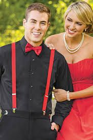 Black dress shirt with red suspenders and a red bow tie