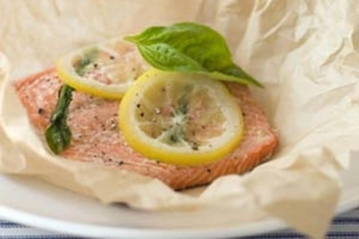 This classic and extra simple method for steaming fish en papillote (or inside parchment paper packets) yields juicy, tender results for everything from salmon to tilapia. If desired, use two or three of the suggested additions below (olives, tomatoes, etc.) to flavor the fish as it cooks.