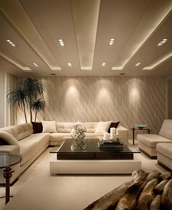 Strategic lighting highlights textured living room walls
