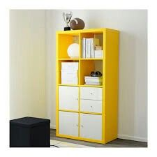 Yellow kallax with white cupboards