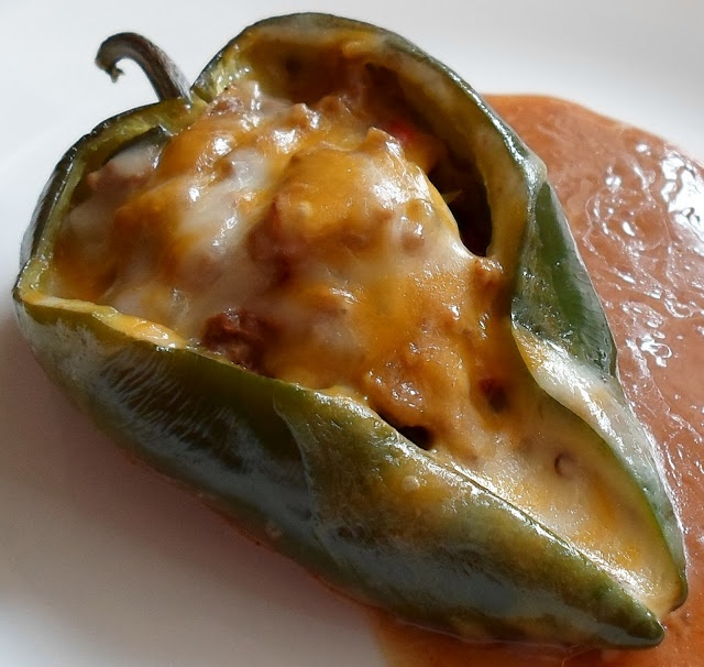 Beef Enchilada Stuffed Pablano Peppers...Serve with a fiesta green salad and cold cervaza!!!!