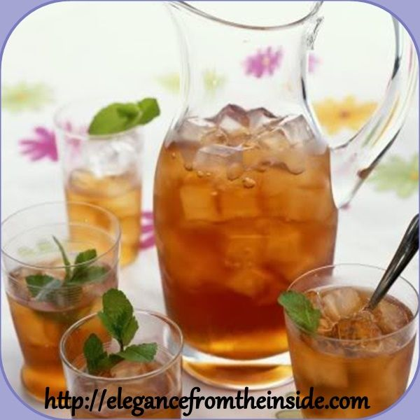 Iced tea on a hot day with lemon slices and mint is very good for your inner well being and health.