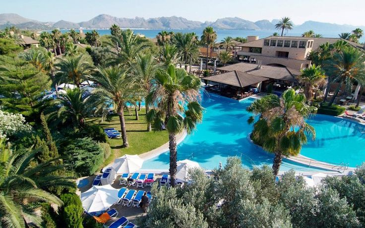 A guide to the best family-friendly Majorca hotels, featuring the top places to stay for safe beaches, kids' clubs, swimming pools, watersports, tennis and babysitting, in locations including Port de Pollença, Es Trenc, Playa de Palma, Puerto de Alcudia and Cala Millor