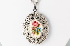 Vintage Victorian revival floral cross stitch locket necklace, 1970s. Gorgeous silver chain and filigree oval locket with stitched rose