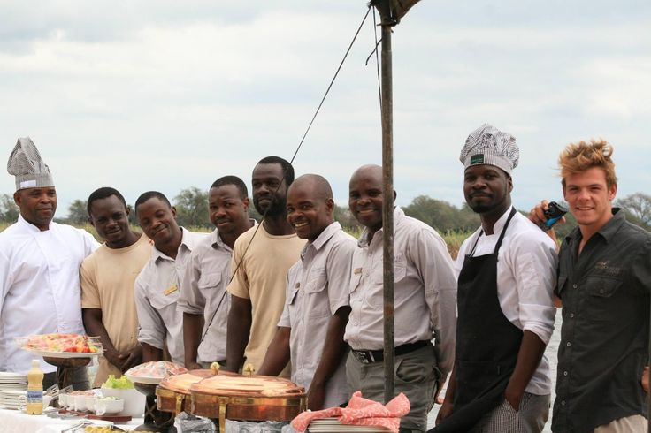 Meet the team behind Little Ruckmomechi's memorable Mana Pools moments  - the Bennett group won't quickly forget this amazing brunch setup on an island in the middle of the Zambezi River!     Image courtesy Ruckomechi manager Edmond Mudzimu.    Click on the pic to find out more about what to expect from a safari to this extraordinary Zimbabwean national park.