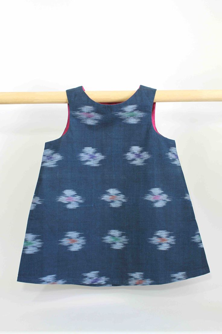 Dark Blue Blur Dress with Pink Lining: This super cute summer dress not only looks great on kids but is also comfortable to wear and easy to clean, making it perfect for all occasions and still allowing a kid to be a kid.