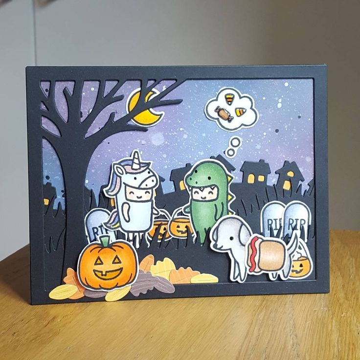 A Halloween scene using Lawn fawn stamps and dies.