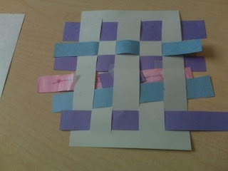 Great art project to help children understand the opposite concepts of under and over: Paper weaving!