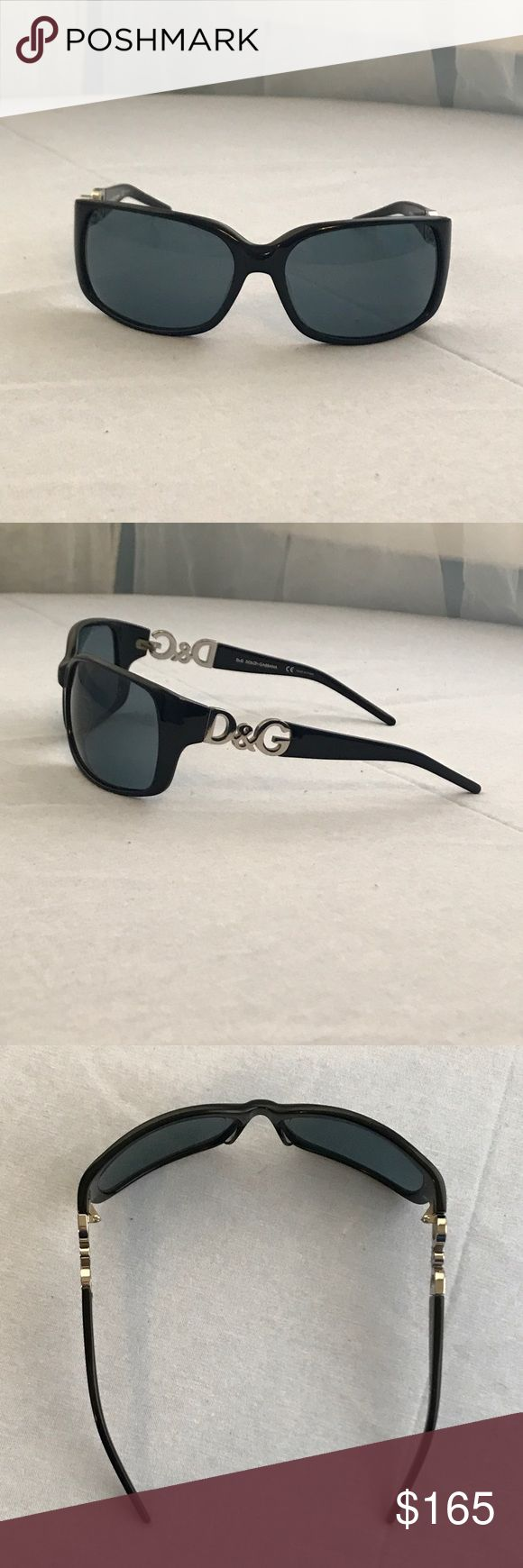 Dolce and Gabbana Sunglasses Dolce and Gabbana Sunglasses Black Frames and Lenses.  This curve hugging silhouette with distinct silver DG logo melds contemporary elegance with high fashion accessories.  Excellent Used Condition, case included. Dolce & Gabbana Accessories Sunglasses