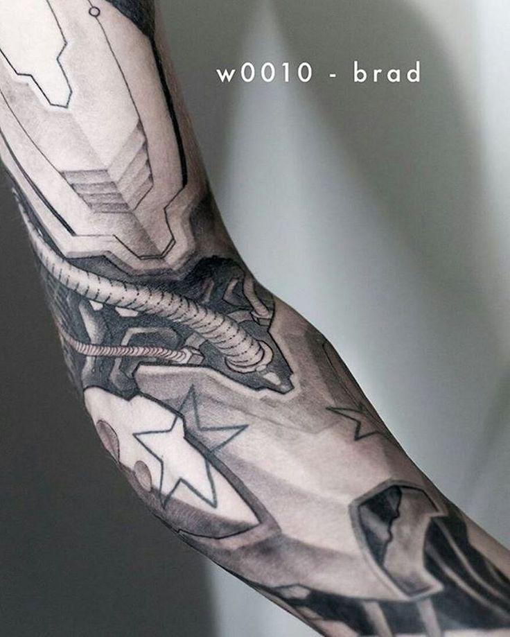black and grey cyborg sleeve tattoo idea