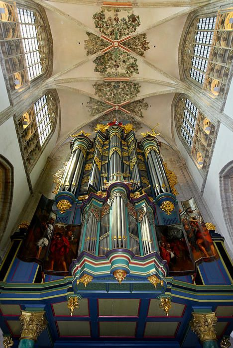 The pipe organ in the Grote Kerk, Breda, the Netherlands, is a variety of bright, deep colours - greens, blues, reds. The original organ was installed in 1534, and it was last rebuilt by Van den Heuvel in 2000in 1969. It has 53 stops, 4 manuals and pedal and in total has 3780 pipes.
