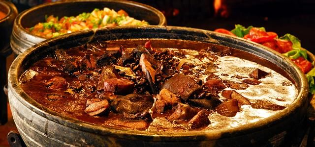 Brazilian Feijoada: a stew of beans with beef and pork, which is a typical dish in Portuguese and Brazilian cuisine.