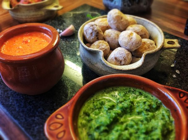 "Potatoes with two sauces - ""Anyone that has visited the Canary Islands would have seen these served with nearly every dish. These little salty and delicious potatoes are amazing when served with Mojo Picon and Mojo Verde sauce. These are another must try recipe. Absolutely delicious."""