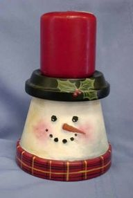 Snowman Clay Pots.  Put another pot instead of candle.  Paint black to make it look like top hat.