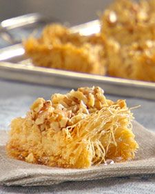 This classic Albanian dessert of shredded phyllo dough is dusted with vanilla sugar and walnuts and baked until golden brown.