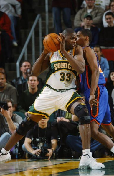 Center Jerome James of the Seattle SuperSonics drives past forward Kurt Thomas of the New York Knicks during the NBA game at Key Arena in Seattle...