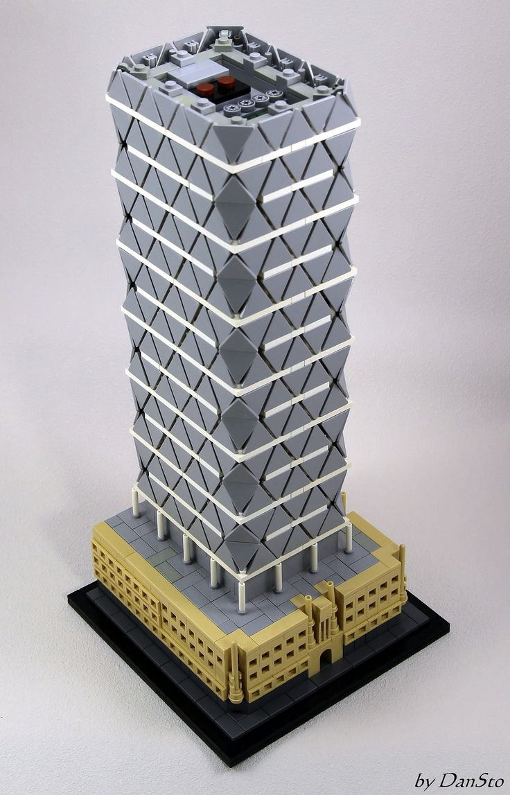https://flic.kr/p/UGBMxo   NY Hearst Tower (AVG)   A LEGO interpretation of the New York City Hearst Tower ( www.fosterandpartners.com/projects/hearst-tower/ ) using the trianguar roadsign. The triangles of the tower being not equilateral whereas the LEGO triangles are, I had to increase the number of levels in order to keep the height over base ratio.  For details on the corners, see www.flickr.com/photos/77709542@N06/34523875111/in/album-7...