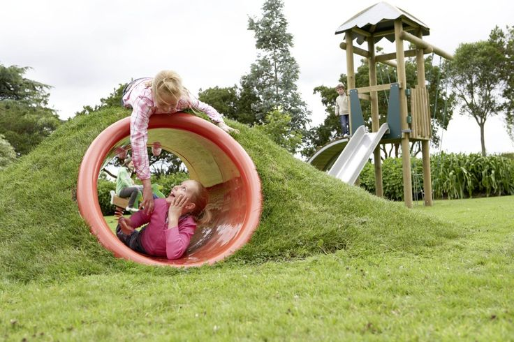 This outdoor learning space is beneficial for children. It allows a child to be able to play privately or with another friend. The term that can be used to describe this tunnel is 'cave'. Which is an environment where the child can go to be alone and play privately in their own space.