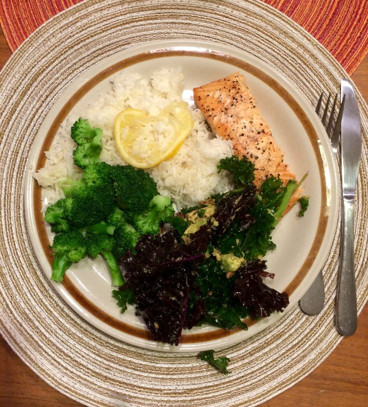 Lemon pepper oven baked salmon with lemon basmati rice, blanched broccoli, and two colour kale salad.