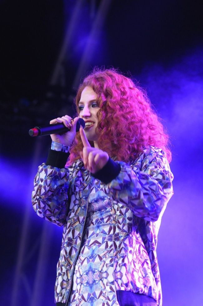 red head with curls | Jess Glynne performing at the Summer Series at Somerset House in London.