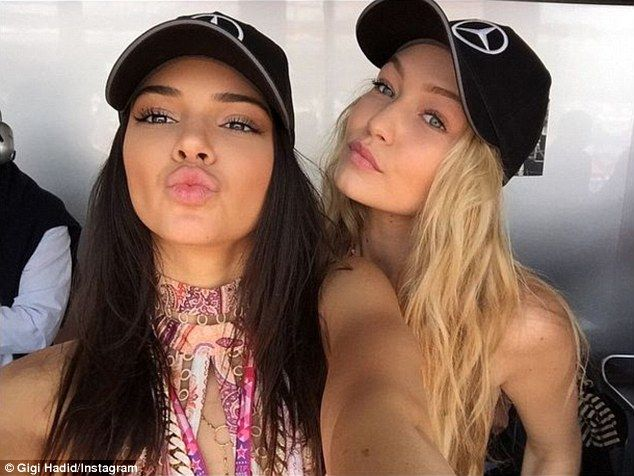 Show of support: Kendall and Gigi donned Mercedes caps as a nod to their friend Lewis...