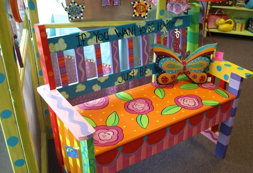 Fun hand painted bench with roses and wacky patterns