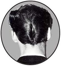 I had a DA (Ducks Ass) haircut in 9th grade.....wow....was that ever the style back then....guys & girls!