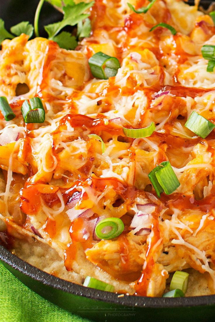 Oven Baked BBQ Chicken Pizza Nachos | Oven baked BBQ chicken pizza nachos... the awesome combination of homemade bbq sauce, juicy chicken, gooey cheese and tons of toppings!  A recipe that's perfect for the big game or as a fun snack or appetizer! | http://thechunkychef.com