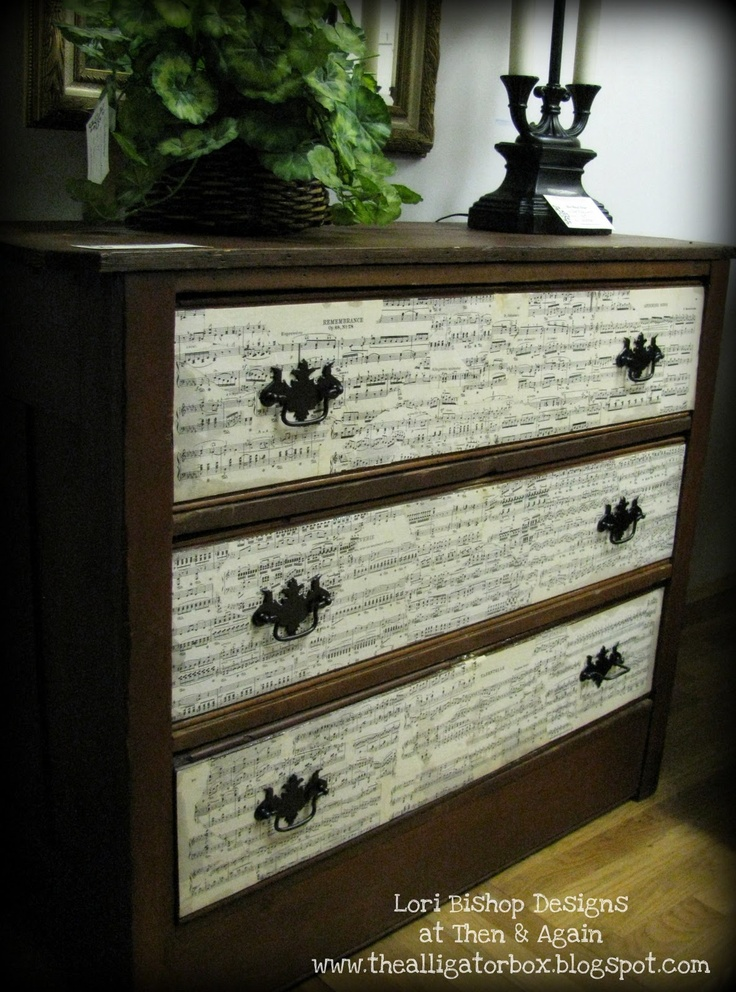 This dresser re-do is easy and beautiful! Just get yourself a wardrobe or chest of drawers your tired of and revamp it with piano sheet music. Attach with modge podge and add additional poly-acrylic sealer if needed. Check out Lori Bishop Designs for more ideas and sheet music DIY projects