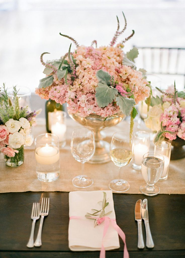 beautiful soft lighting. try a soft colored runner on a farm table to achieve this look. also love the sweet side bow on a folded napkin; so lovely!