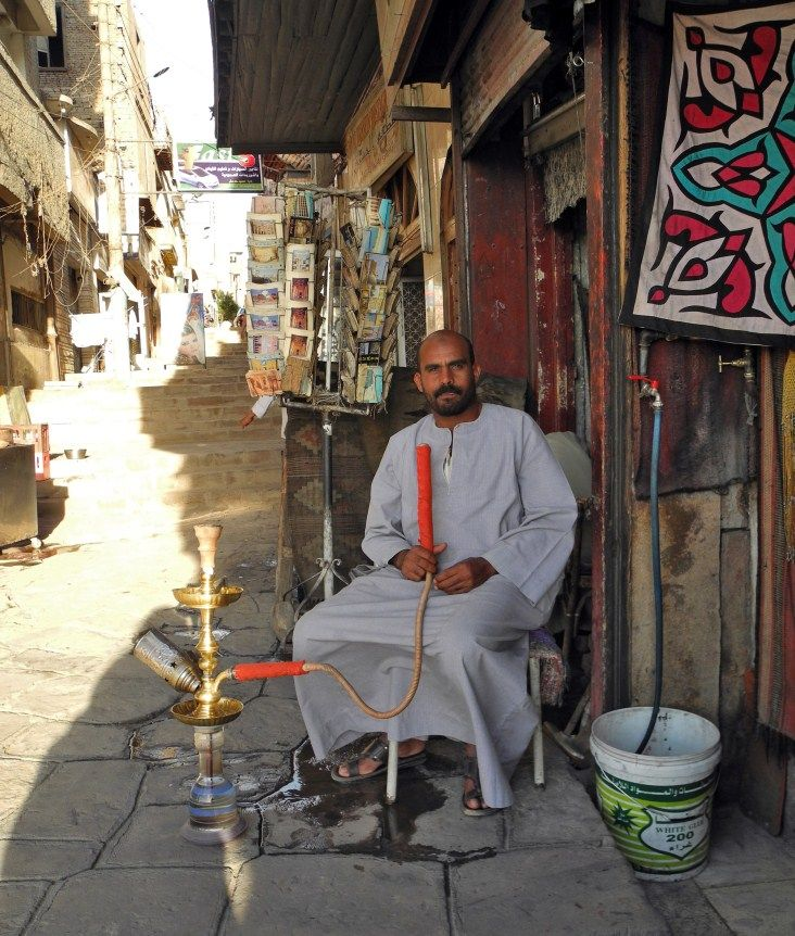 Egypt locals taking it easy smoking pipe.